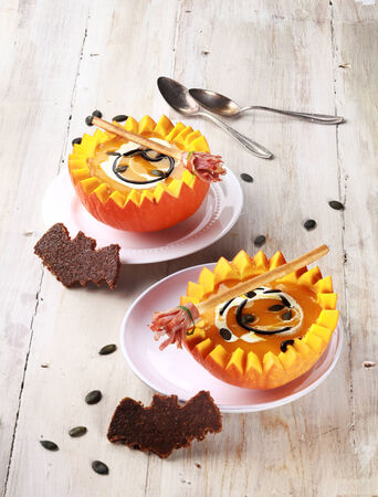 broomsticks: Two Pumpkin Soups with Bat Shaped Crouton Toasts and Broomstick Breadstick Served in Half a Pumpkin with Spoons