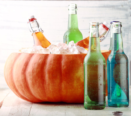 Bottled Beverages Chilling in Pumpkin Ice Bucket photo