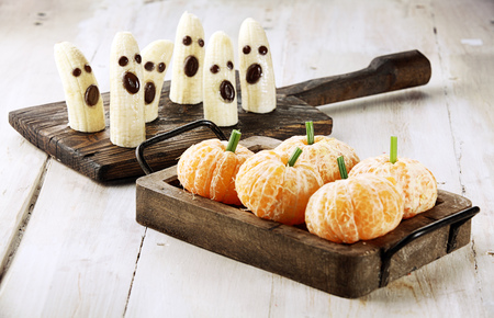 fruit of the spirit: Healthy Fruit Halloween Treats made into Banana Ghosts and Clementine Orange Pumpkins