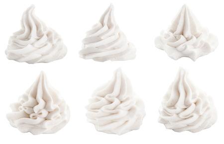 alimentos congelados: Set de blanco remolinos decorativos de salsa de un postre conceptuales de yogurt congelado, helado o crema batida, aislado en blanco Foto de archivo