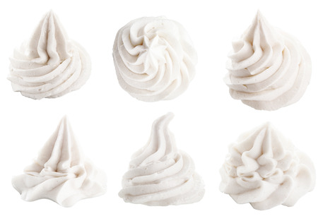 Set of six different white decorative swirling toppings for dessert isolated on white depicting whipped cream, ice cream or frozen yogurt