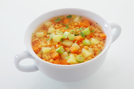 protein crops: Nutritious vegetarian cuisine with a bowl of lentil, leek and carrot soup, rich in protein and dietary fiber