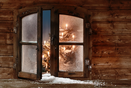 windowpanes: Snow at Open Vintage Wooden Christmas Window Pane, Captured with Christmas Lights Inside.