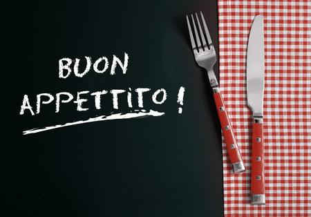 buon: Close up Silverware on Red White Checkered Table Cloth at Buon Appettito Stock Photo