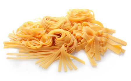 durum wheat semolina: Close up Homemade Fresh Flat Italian Pasta on White Background.