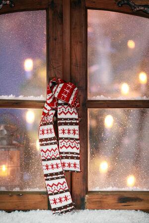 window pane: Close up Christmas Scarf Hanging at Vintage Wooden Window Pane