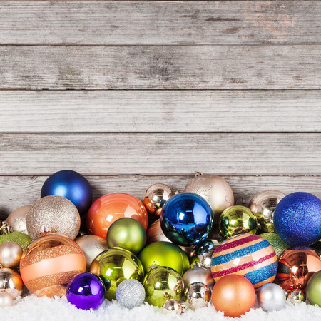 Close up Plenty of Attractive Christmas Balls in Different Sizes on Wooden Wall  photo