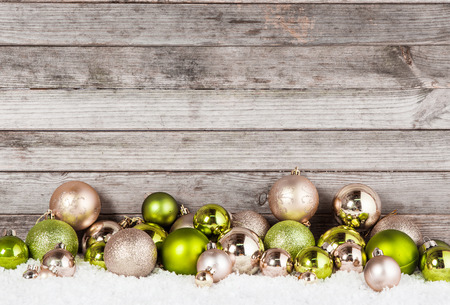 Close up Plenty of Stunning Green and Brown Christmas Ball Ornaments for Holiday Season with Vintage Wall Background. Banque d'images