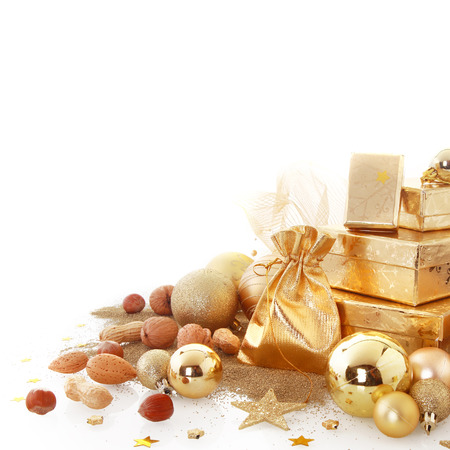 Close up Various Attractive Gold Brown Christmas Decorations with Balls, Santa Sack, Stars, Presents and Nuts, Isolated on White Background. photo