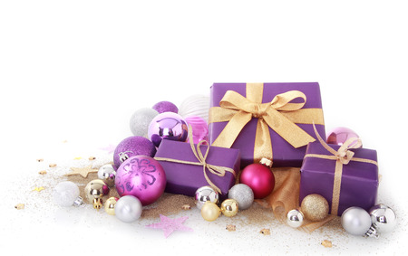 Close up Nice Purple Gift Boxes with Assorted Size Purple, Silver and Gold Christmas Balls. Isolated on White Background.