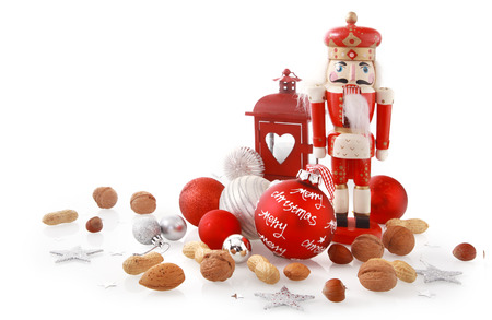 Close up Brown, Silver and Red Christmas Items with Nuts, Balls and Nutcracker, Isolated on White Background. Stock fotó