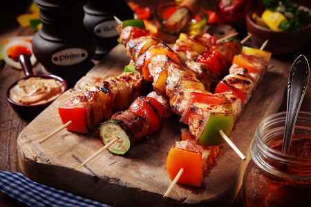 Close up Mouth Watering Gourmet Barbecue on Wooden Chopping Board at the Table. photo