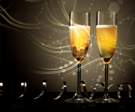 twirled: New Year, wedding or anniversary background of two elegant flutes of champagne with swirling light and twirled party streamers or ribbons with copyspace for your greeting on a dark background