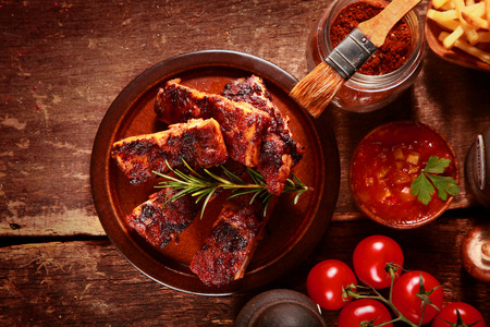 marinate: High Angle Looking Down at Saucy Barbecued Spareribs Surrounded by Various Ingredients