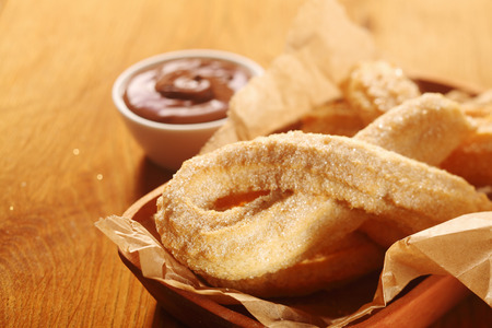 churros: Close up Mouth Watering Churros Snacks on Tray with Chocolate Dipping Sauce. Stock Photo