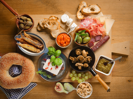 grapes and mushrooms: High Angle View of Various Tasty Tapas on Wooden Board on Top of Wooden Table