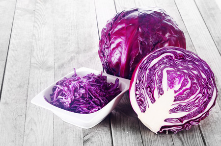cabbages: Close up Shredded, Sliced and a Whole of Purple Cabbage Vegetable on Top of Wooden Table