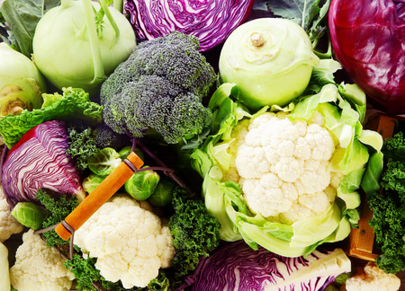 Background of healthy fresh cruciferous vegetables with brioccoli, cabbage, cauliflower, brussels sprouts kale and kohlrabi, close up full frame