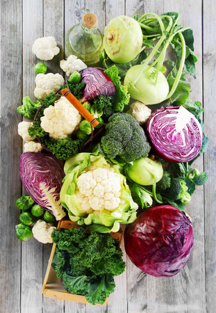 low carb diet: Close up Assorted Healthy Fresh Vegetables on Wooden Table. Emphasizing Cabbage, Broccoli, Cauliflower and Brussels Sprout