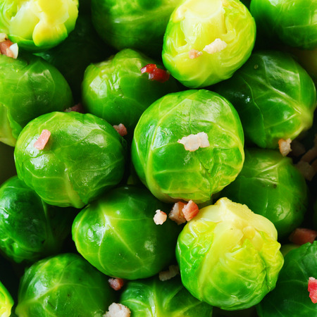 cruciferous: Background texture of fresh steamed, boiled or microwaved brussels sprouts with savory seasoning, square format