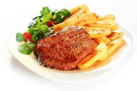frites: Gourmet Grilled Meat with French Fries on White Plate, Isolated on White Background.