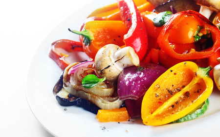 sweet and savoury: Delicious vegetarian meal or grilled or roast vegetables with sweet pepper, mushrooms, onions and herbs serve on a white plate