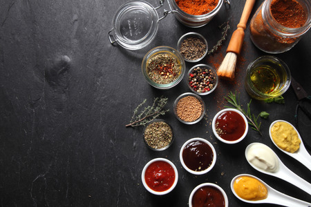 marinate: Various Spicy Ingredients for Recipe on Black slate Table with Copy Space on Left Side.