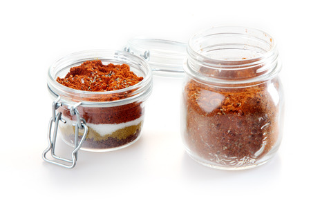 Close up Rub and Marinade Powder on Glass Jars, Isolated on White Background. Stock Photo