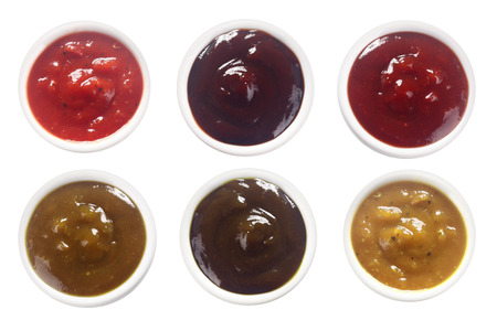 bbq background: Close up Aerial Shot of Assorted Spicy Sauces on Saucers, Isolated on White.