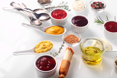 Close up Assorted Fresh Condiments on White background with Herbs Stock Photo