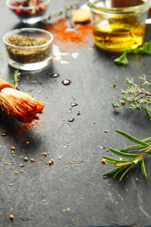 messy kitchen: Close up Messy Black Kitchen Table with Fresh Herbs and Spices for Recipe. Stock Photo