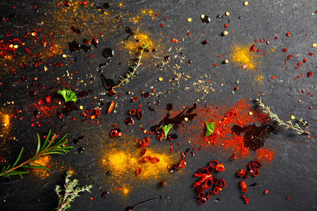 Close up Rub and Marinade Powder and Sauce Scattered on slate Table Imagens