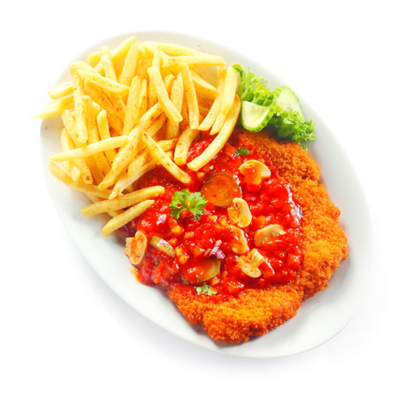 top angle: Close up Gourmet Crumbled Escalope with Gravy Paired with French Fries on White Plate, Isolated on White Background. Stock Photo