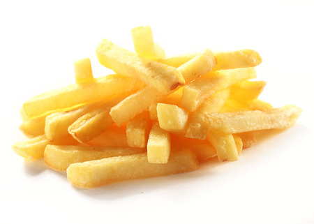 Heap of crispy golden deep fried French fries or potato chips for a tasty takeaway finger food or snack on a white background Stockfoto