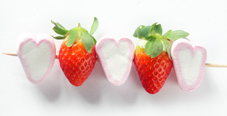 Close up Heart Shape White Marshmallows and Strawberries on Stick, Isolated on White Background. photo