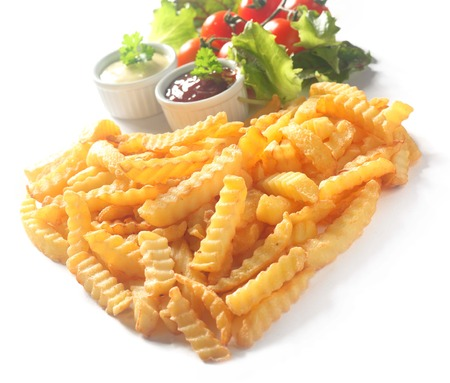 crinkle: Crinkle Cut French Fries with Ketchup and Mayonnaise Dips and Tomato and Lettuce Garnish on White Background