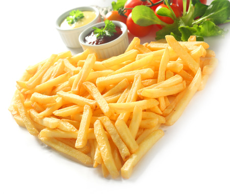 angled view: Angled View of Straight Cut French Fries in Heart Shape with Ketchup and Mayonnaise Dips and Tomato and Lettuce Garnish