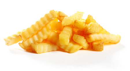crinkle: Heap of golden fried crinkle cut potato chips or French fries for a delicious snack or appetizer isolated on white