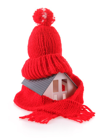 warm house: Close up Conceptual Miniature Model House with Red Wool Scarf Hat, Isolated on White Background. Stock Photo