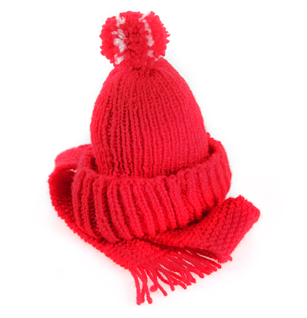 woolly: Colorful red knitted fashionable warm winter scarf and beanie hat with a pompom isolated on white Stock Photo