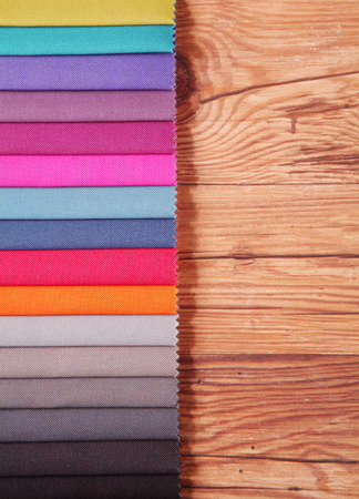 emphasizing: Color Palette Guide for Home Interior in Horizontal on Top of Wooden Table, Emphasizing Copy Space. Stock Photo