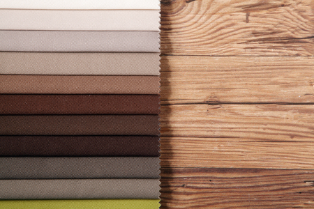framer: Various Brown Combinations Home Interior Palette Guide on Top of a Wooden Table with Copy Space on the Right.