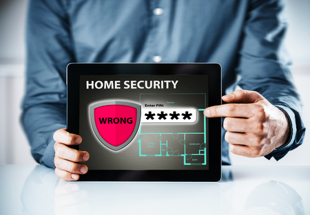 security icon: Home security online warning for a wrong code or password to gain access to the control interface for a smart house with a red shield icon containing the word - Wrong - overlaying a house floor plan Stock Photo