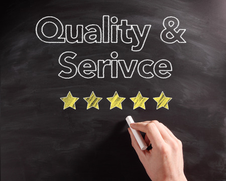 five stars: Conceptual Handwritten Service and Quality Texts on Black Chalkboard with Five Stars Drawing.