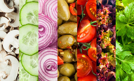 frilly: Background collage of diced fresh vegetables for a healthy vegetarian diet showing mushrooms, cucumbers, olives, tomato, frilly lettuce and parsley in parallel bands