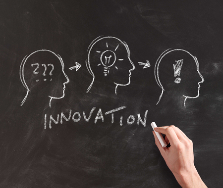 progression: Hand Illustrating Progression of Innovation from Problem to Idea to Solution on Chalkboard Stock Photo