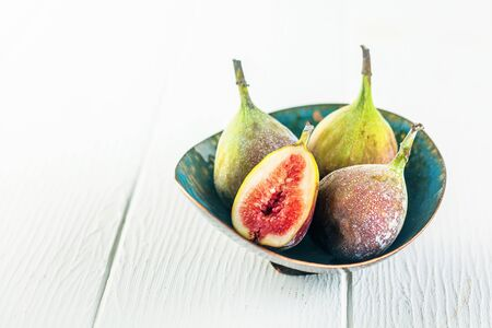 laxative: Pretty handmade green pottery bowl of ripe fresh juicy succulent figs