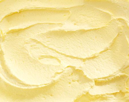 すぐにフルフレームをバナナのアイスクリームの渦巻いた黄色着色されたアイスクリームの御馳走 写真素材