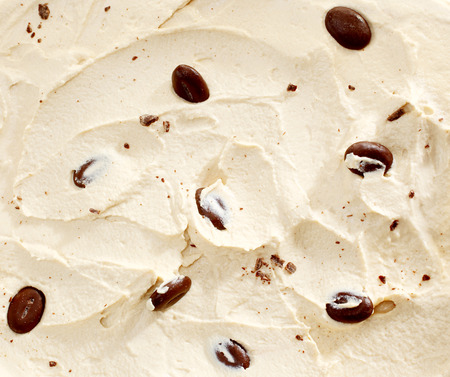 vanilla ice cream: Vanilla creamy ice cream flavored with roasted coffee beans, to be served as a frozen tasty dessert, close-up Stock Photo