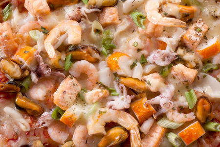 smothered: Extreme Close Up of Seafood Pizza - Bounty of Shrimp, Mussels, Calamari, and Crab Smothered in Cheese on Top of Pizza,